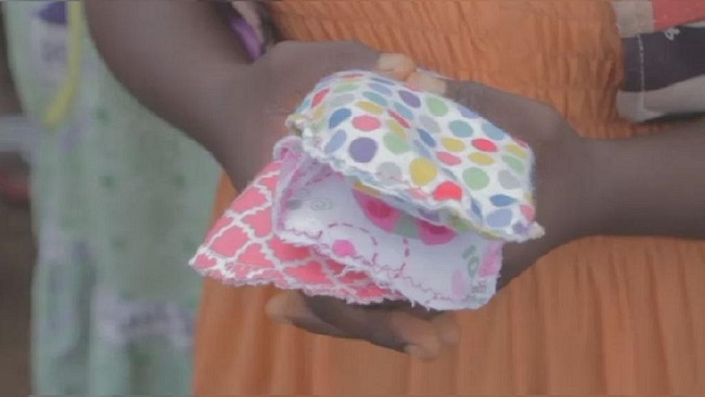 Cameroonian teacher makes re-usable pads to help girls stay in school
