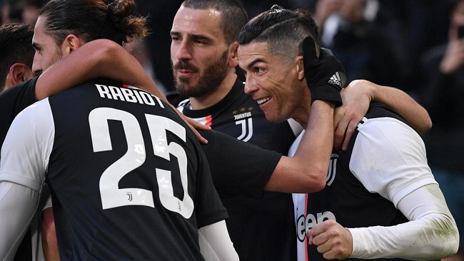 Football: Ronaldo hat-trick puts Juventus top as Ibrahimovic returns in Milan stalemate