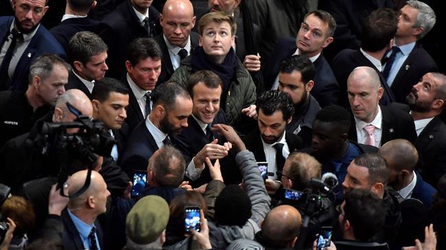 Scuffles break out as France's Macron visits farm fair