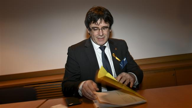 German court keeps exiled Catalan leader Puigdemont in custody