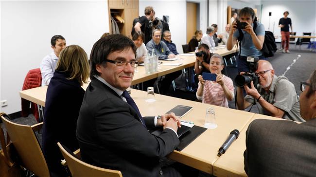 Spain: Catalan separatists again back fugitive leader for president