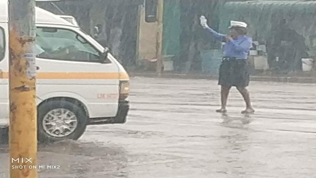 Zambia police constable promoted for braving heavy rain to control traffic