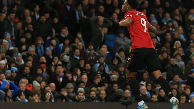 Football: United win battle of Manchester to leave City 14 points off top
