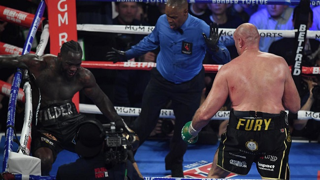 Boxing: Fury batters Wilder in TKO triumph in WBC heavyweight title rematch