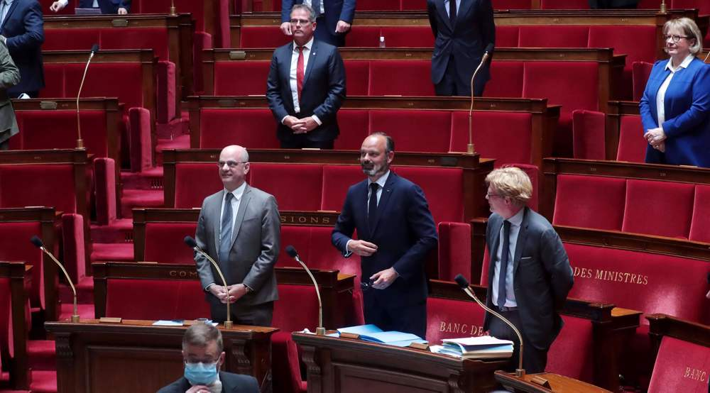 Defections rob France's Macron party of parliamentary majority