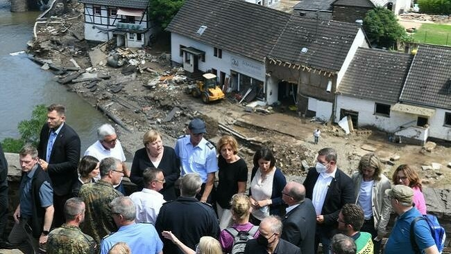 Bundes: Dr Merkel visits areas devastated by 'terrifying' floods as death toll tops 180 in Europe