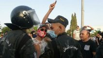 Clashes erupt outside parliament after Tunisian president ousts PM, suspends legislature